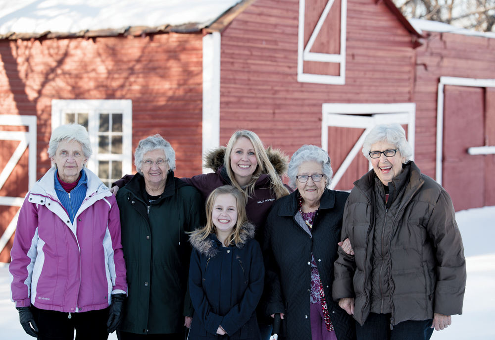 C.C. and Anna's descendants still regularly gather at Evergreen Farm. From left to right are sisters Eleanor Dueck, Erma Klassen, great-granddaughter Ashlyn Meek, granddaughter Blayne Meek, and sisters Gladys Isaac and Ruth Ratzlaff.