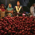 Indian customers purchase onions at a vegetable market last year. In September and October, farmers' holding back of supplies of onions, a staple of many Indian dishes, forced the government to organize emergency supplies from China and Iran to calm record prices ahead of elections in five states.
