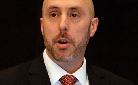 Man talking at a conference.