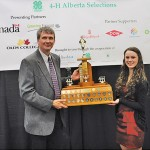 Jess Verstappen receives the 4-H Premier's Award from Rod Carylon of the Rural Development division of Alberta Agriculture and Rural Development.