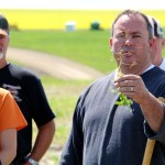 Michael Harding shows a group of onlookers a diseased pea root at a recent Alberta Pulse Growers crop tour in Three Hills.