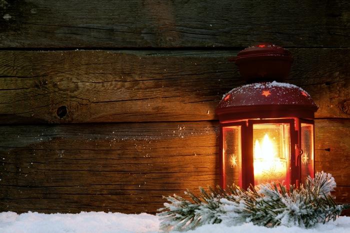Christmas lantern light in night on snow