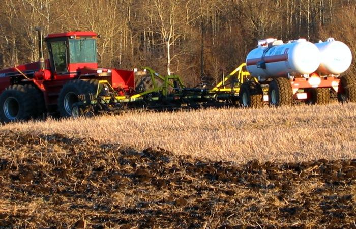 farm machinery fertilizing a field