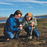 Janine Paly and student Kris Vaculchik assess a winter wheat project near Vermilion conducted by Ducks Unlimited Canada and Lakeland College last year.