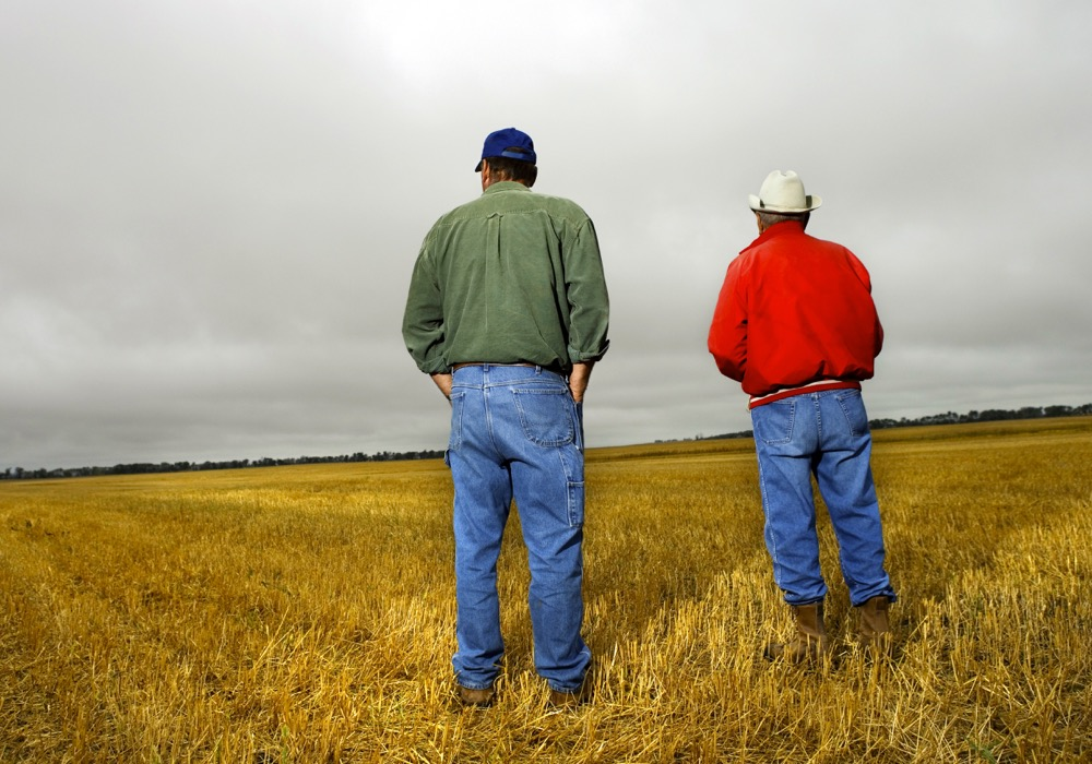 Men standing in field