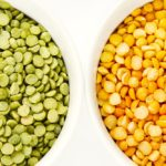 Green and yellow peas in white bowls
