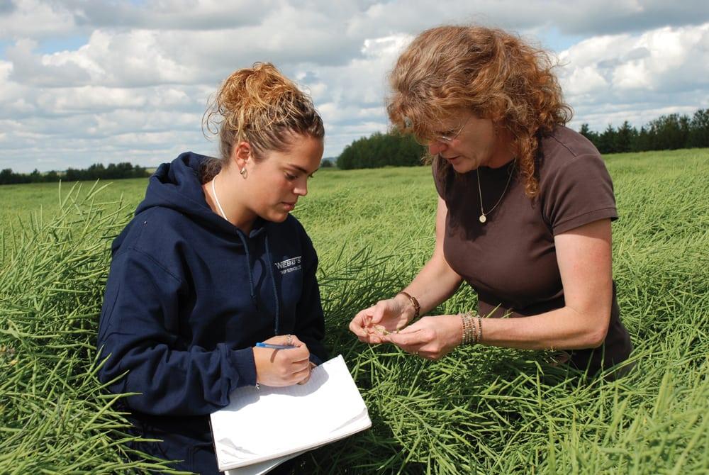 Enrolment in Lakeland College's agriculture sciences program has almost tripled since Josie Van Lent (r) (seen here with former student Sheena McKelvie) became dean in 2007.