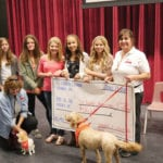 Recent school shootings prompted five high school students to raise money for St John Ambulance's Therapy Dog program. From left to right are Michelle T. with her therapy dog Niko, Elizabeth King, Tatum McCuaig-Vredegoor, Emma Nelson, Jade Pahl, Neely Antosh, and Shona S. with her therapy dog Zeus.