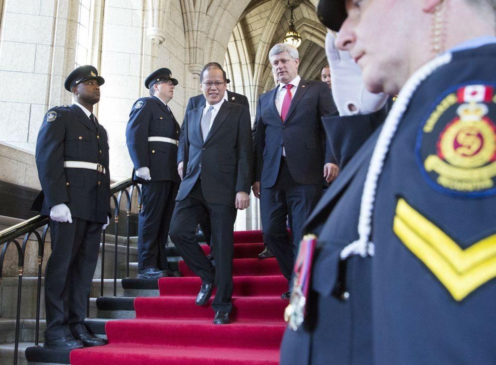 Prime Minister Stephen Harper and Benigno Aquino, president of the Philippines, leave Parliament Hill at the end of Aquino's visit to Ottawa. (Deb Ransom photo courtesy PMO)