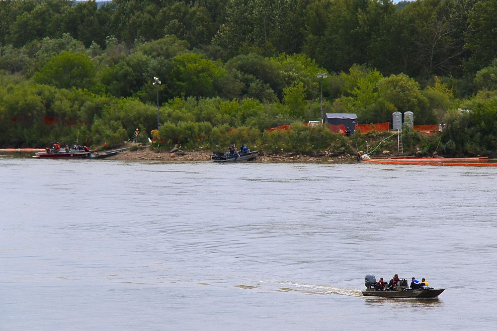 Workers finish a lunch break near the Toby Nollet Bridge and head back out to continue cleaning up the North Saskatchewan, following the Husky oil spill in July. (AGCanada.com Network photo)