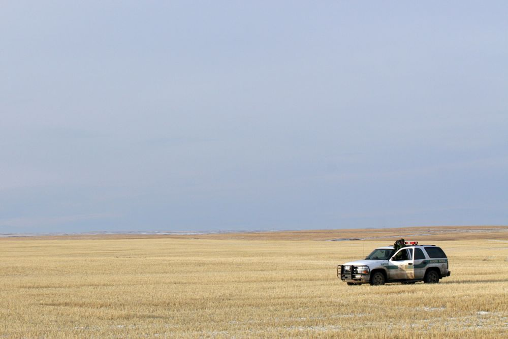 A U.S. Customs and Border Protection agent monitors the Canada/U.S. border near Sweet Grass, Montana, about 100 km southeast of Lethbridge. (CBP.gov)