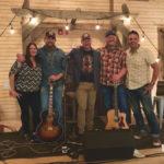 Blake Reid (second from left) with fellow Alberta songwriters Joni Delaurier, Duane Steele, Dustin Farr, and Troy Kokol.