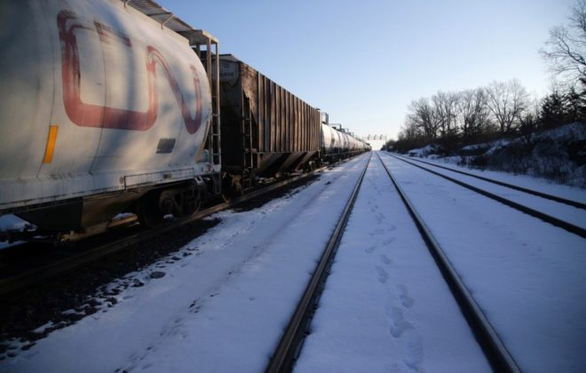 A CN freight train remains halted as train tracks are blocked two km away at Tyendinaga, Ont., east of Belleville, on Feb. 14, 2020. (Photo: Reuters/Chris Helgren)
