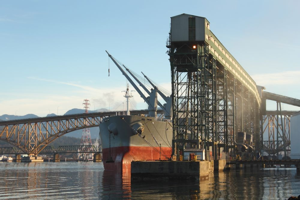 A freighter is loaded with grain from a terminal at Vancouver's Burrard Inlet. (Maxvis/iStock/Getty Images)
