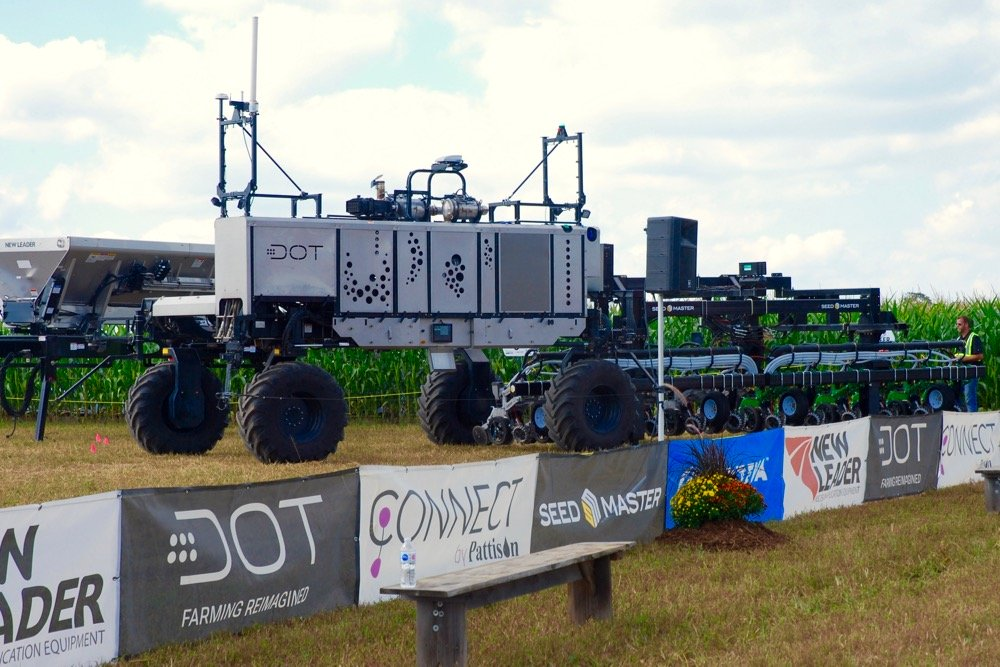 "The U-shaped DOT A-U1 ""loads"" a SeedMaster row-crop planter on to its platform during a demonstration at Canada's Outdoor Farm Show in September 2019. (Ralph Pearce photo)"