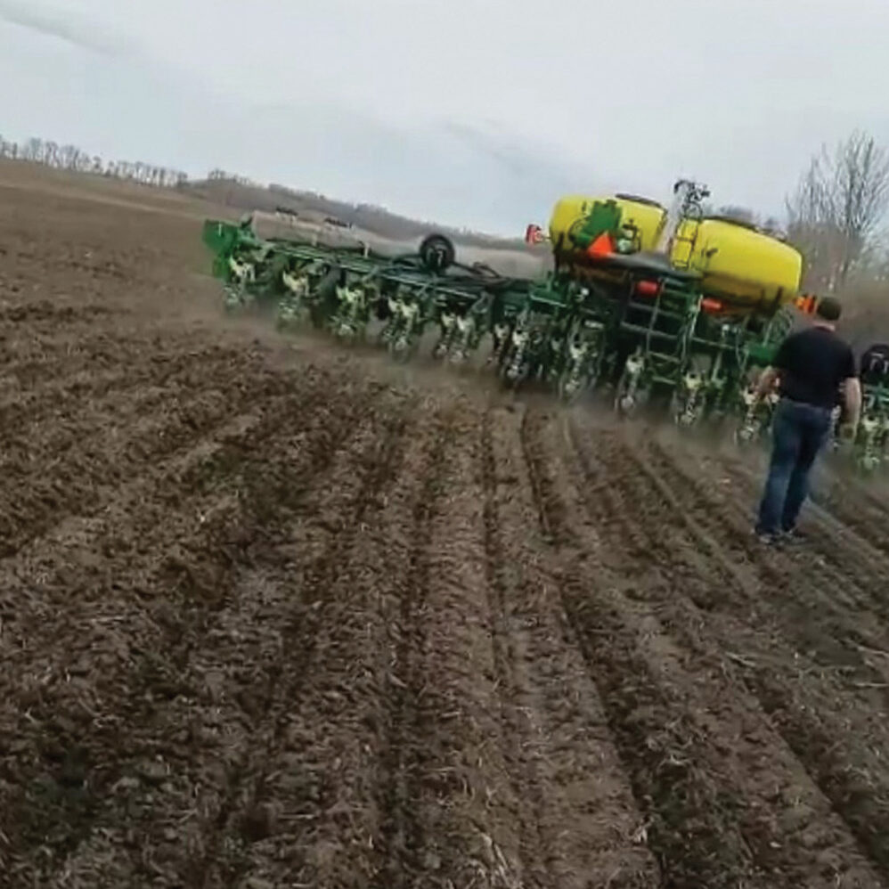 The Olson family has been seeding some canola with a corn planter on their operation near Pine Lake for the past two years. But this year will be the real test as they plan to plant all their canola this way.